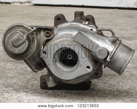 Old and used turbocharger, engine spare part