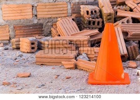 Construction Cone In Construction Site With Bricks