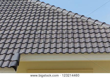 black rood tiles on house with blue sky