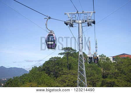 DALAT, VIETNAM - DECEMBER 21, 2015: A cable car ride to Cap Treo Da Lat. The landmark of Da Lat. Tourists come to the monastery