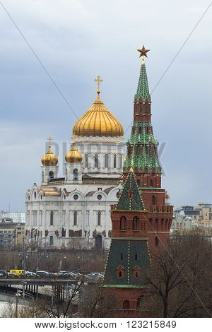 MOSCOW, RUSSIA - APRIL 15, 2015: Christ the Savior Cathedral and the Tower of the Moscow Kremlin in april day. The historic landmark of the city of Moscow