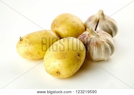 High Carb Unpeeled Potatoes And Garlic Heads Isolated On White