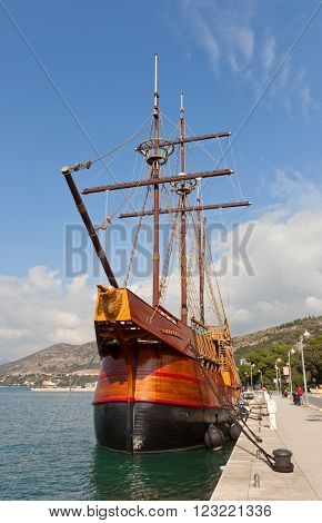 DUBROVNIK CROATIA - FEBRUARY 19 2016: Motor sailboat Karaka (2004) in port of Dubrovnik Croatia. Replica of 16th c. sailing vessel karaka type provides cruises around Dubrovnik (UNESCO site)