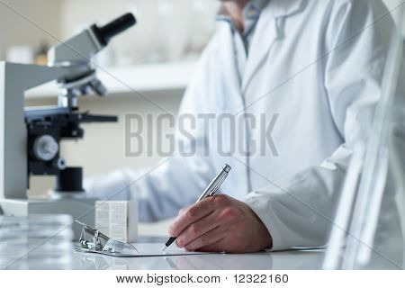 Scientist Conducting Research With Microscope