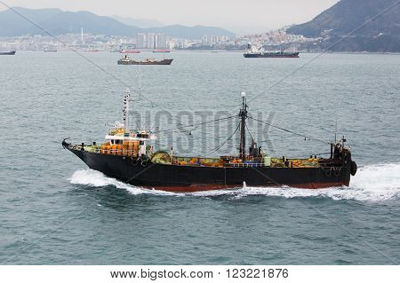Busan South Korea - November 23th 2015: Busan road of the port of Busan anchorage of sea vessels crosses the South Korea fishing vessel No.507.
