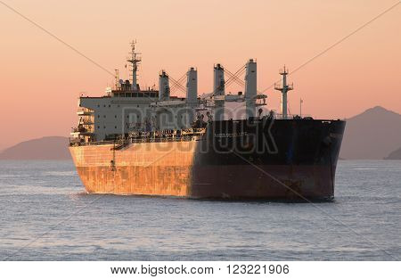Busan, South Korea - February 10th, 2016: Busan, road of the port of Busan, anchorage of sea vessels, the NAESS RESOLUTE bulk carrier costs on an anchor.