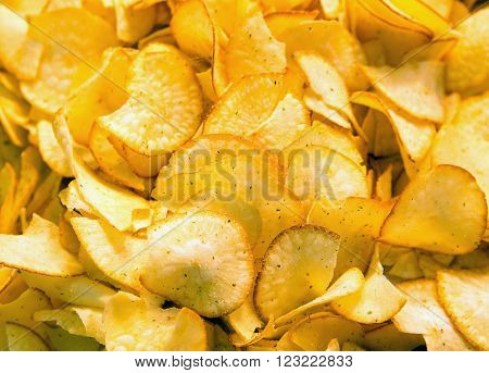 Photo of pieces of salty fried potatoes