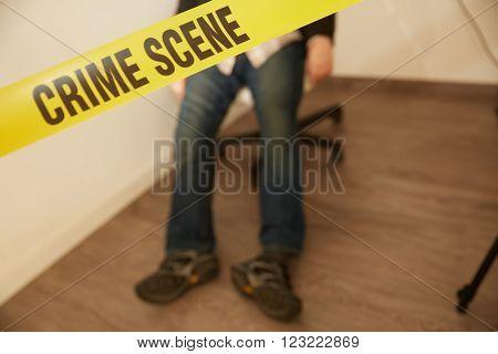 unrecognizable murdered body beside a yellow tape