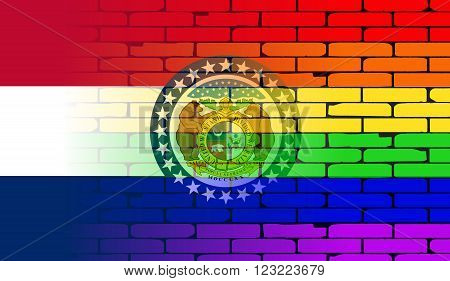 A well worn wall painted with a LGBT rainbow with the Missouri state flag