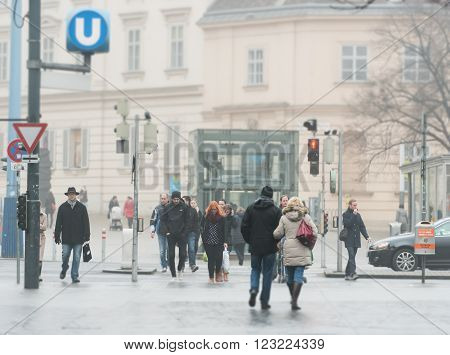 Vienna Austria - 18 January 2014: people crossing street in city centre. Europe travel.