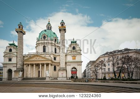 Karlskirche baroque church on Karlsplatz Vienna Austria. Blue cloudy sky in background. Europe travel.