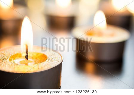 Golden Romantic Candlelights In Bright X-Mas Atmosphere On Wooden Table With Bokeh