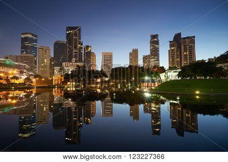 Kuala Lumpur city downtown at before sunrise with reflection of skyline Kuala Lumpur Malaysia.