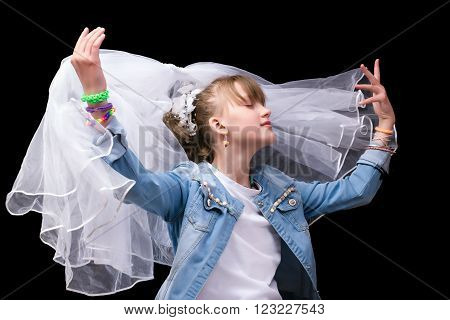 Girl teenager in a youth denim dress and veil. The concept of marriage with minors. Early wedding teenagers. Marrying