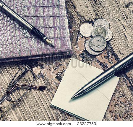 glasses pen and coins close-up notebook business still life retro style