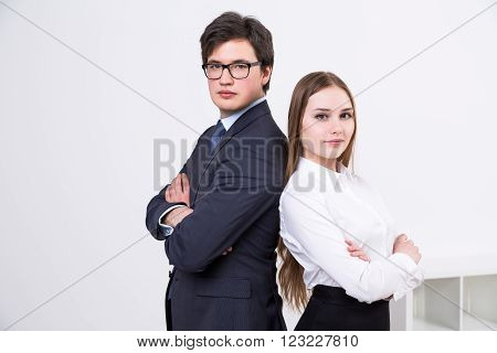 Businessman and businesswoman shoulder to shoulder. Concept of team work.