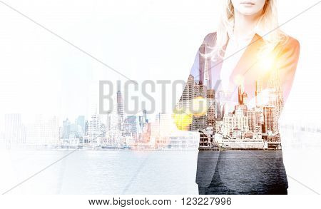 Businesswoman and New York water view. Side viiew. Double exposure. Concept of career.