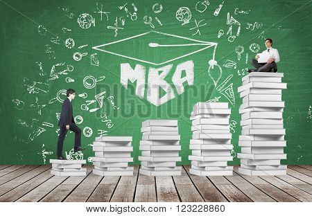 Businessman with laptop sitting on pile of book another climbing book steps MBA and science icons around. Concrete background. Concept of studying.