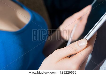 Woman With Big Breasts Holding A Blank Business Tablet Computer In Her Hands ** Note: Shallow depth of field