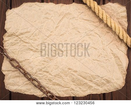 Old crumpled paper on a wooden board .