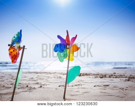 Pinwheel on sand Beach Outdoor Summer holiday background with Blue sky