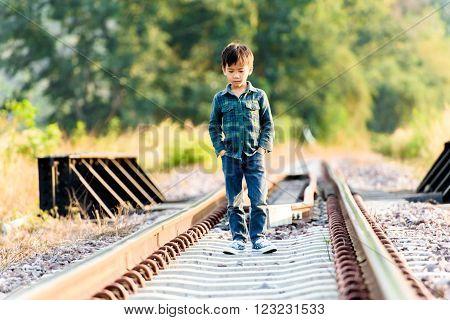 Boy Walk On The Railway