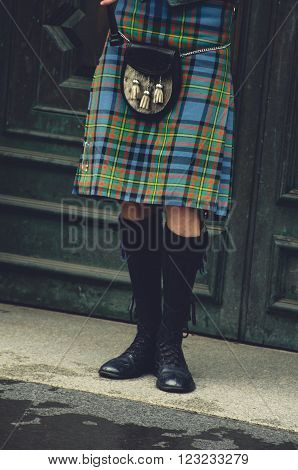 Bagpiper's legs at traditional dress in Edinburgh, Scotland