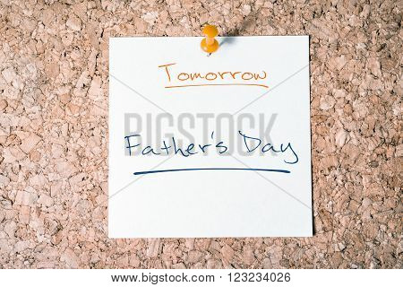 Father's Day Reminder For Tomorrow On Paper Pinned On Cork Board