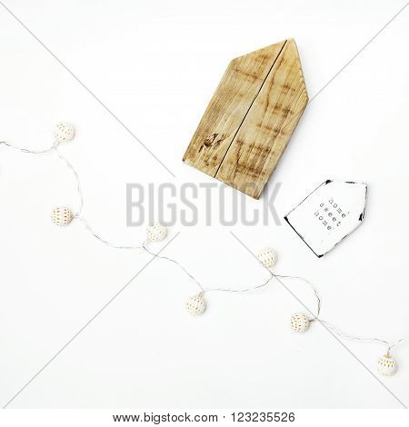 Hipster scandinavian home interior decoration. Tiny wooden houses with MOTIVATIONAL quote HOME SWEET HOME and place for text.
