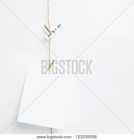 Mock up. Simple garland with card. Hipster scandinavian home interior decoration. With place for text.