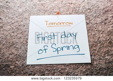 First Day Of Spring Reminder For Tomorrow On Paper Pinned On Cork Board