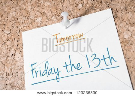 Friday the 13th Reminder For Tomorrow On Paper Pinned On Cork Board