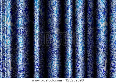 background with blue drapery and abstract pattern