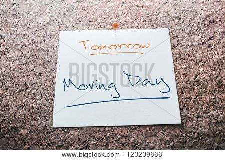 Moving Day Reminder For Tomorrow On Paper Pinned On Cork Board