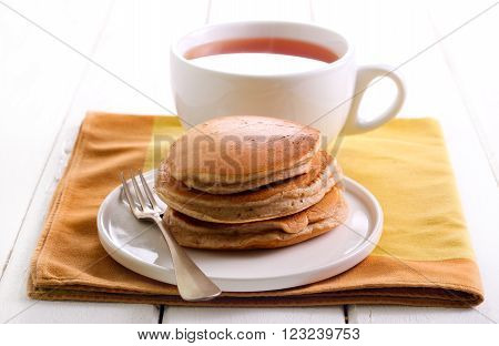 Classical buttermilk pancakes and cup of tea