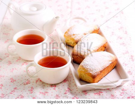 Mini cake loaves with icing and tea