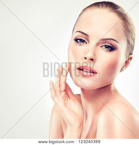 Beautiful  Woman with Clean Fresh Skin close up . Skin care face . Cosmetology and beauty