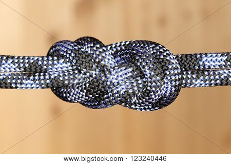 strong double knot with rope on wooden background