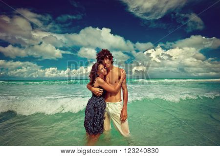 Beautiful hugging  couple near the ocean  .  