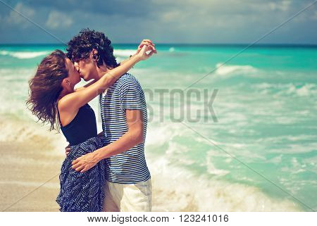 Beautiful Kissing couple near the ocean  .  