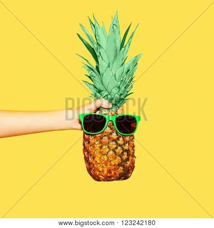 Fashion Pineapple With Sunglasses On Yellow Background, Hand Holding Ananas