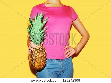 Fashion Woman Holds In Hands Pineapple Over Colorful Yellow Background, Ananas Photo