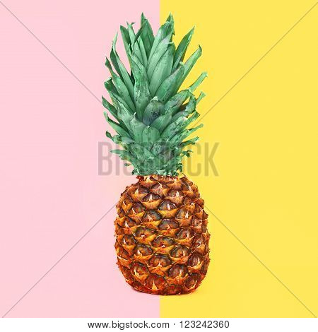 Pineapple fruit on colorful yellow pink background, ananas photo