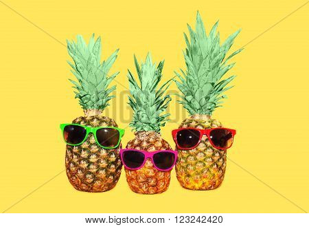 Three Pineapple With Sunglasses On Yellow Background, Colorful Ananas Photo