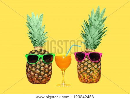 Two Pineapple With Sunglasses And Glass Fruit Juice On Yellow Background, Colorful Ananas