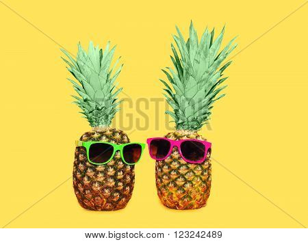 Two Pineapple With Sunglasses On Yellow Background, Colorful Ananas Concept