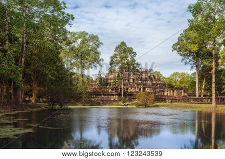 SIEM REAP, CAMBODIA. December 16, 2011.The Baphuon is a temple at Angkor Thom reflecting in the lake.
