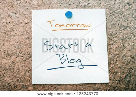 Start A Blog Reminder For Tomorrow On Paper Pinned On Cork Board