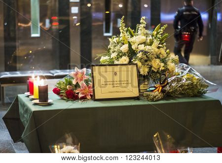 Madrid Spain - March 22 2016 - Flowers candles and message in memory of victims of terrorist attacks in Brussels at Belgium embassy in Madrid Spain