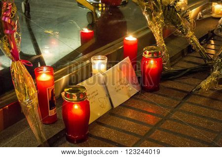 Madrid Spain - March 22 2016 - Candles and envelopes with peace messages about Brussels terrorist attacks at Belgium embassy in Madrid Spain